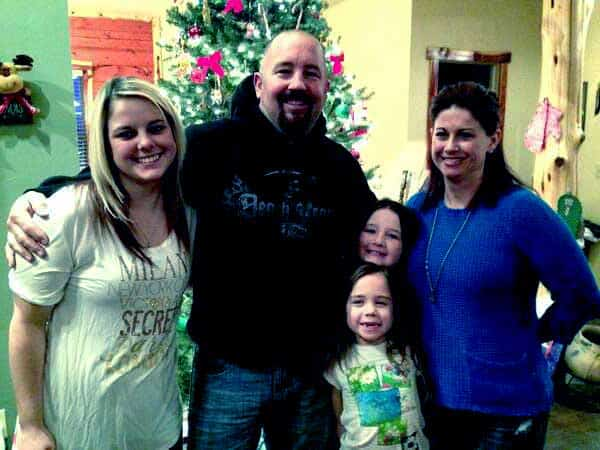Image of Chuck Seitsinger with his wife and three daughters