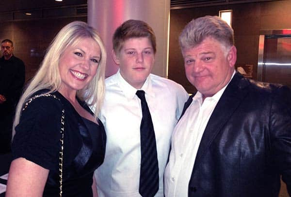 Image of Dan Dotson with his wife Laura Dotson and with his son Garrett