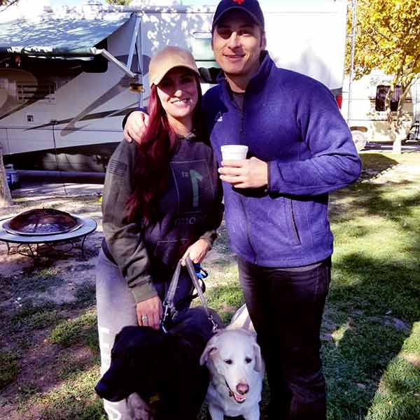 Image of Shana Dahan with her husband Adam Kilbourn and with their lovely pets Labrador