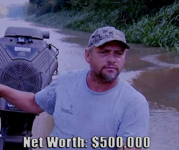Image of Swamp People cast Junior Edwards, and son Willie Edwards net worth is $500,000
