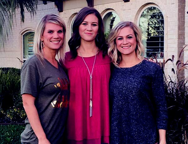 Image of Danielle Busb with her twin sister (Crystal Mills and Ashley Mowbray)