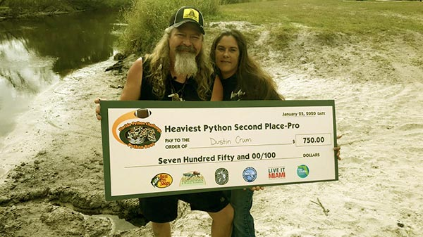 Image of Caption: Dusty and Natalee comes 2nd place in Florida's 2013 python challange