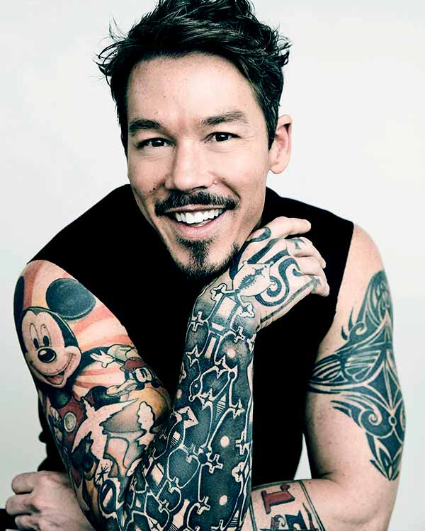 Image of Caption: David Bromstad tattoo of Mickey Mouse on his right shoulder and bicep