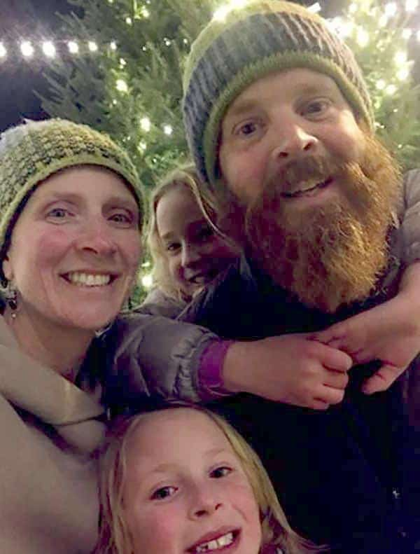 Image of Caption: Chase Morrill with his wife Sarah along with kids