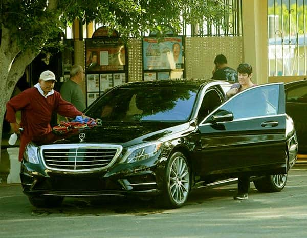 Image of Caption: Connie Kline with her black Mercedes