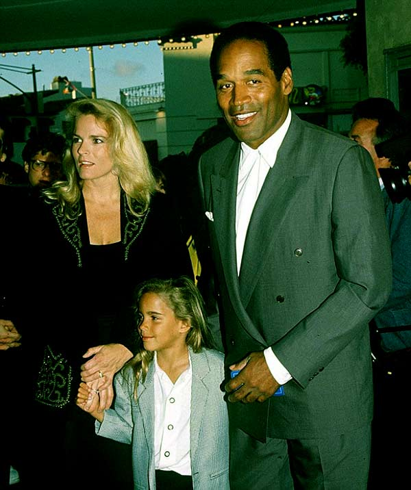 Image of Caption: Sydney Simpson with her father O.J. Simpson and mother Nicole Brown