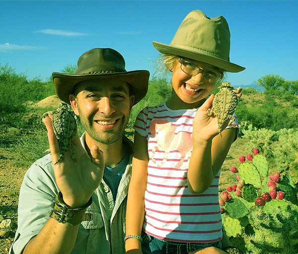 Image of Coyote Peterson with her daughter Pup