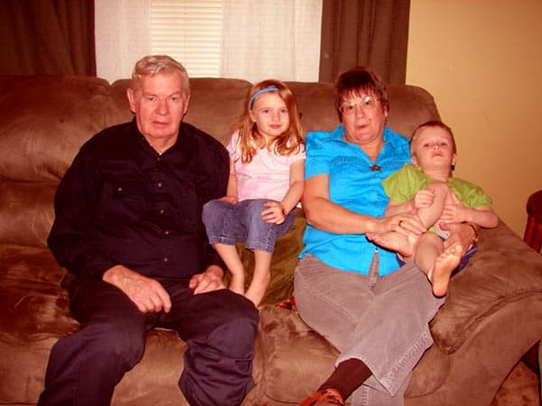 Image of Roger Barr with his wife Susan Barr along with their kids