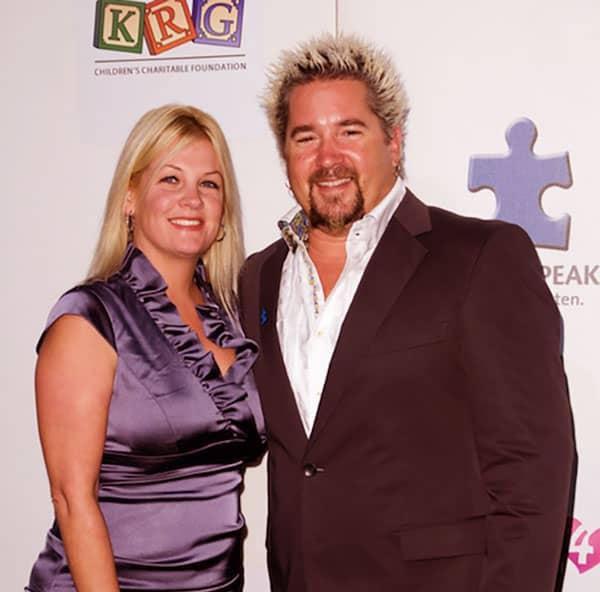 Image of Guy Fieri with his wife Lori Fieri